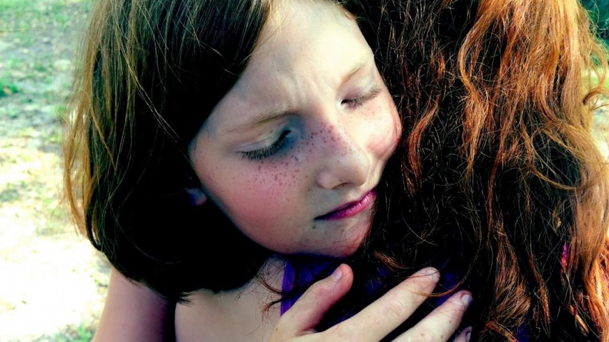 Girl hugging woman.